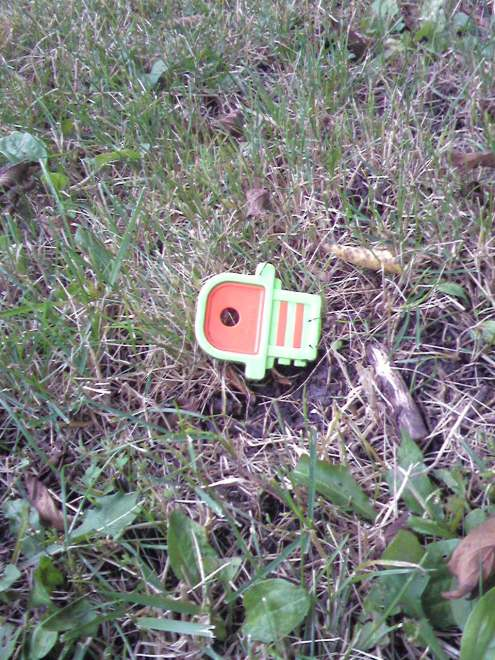 Kid Key. It's a baby toy. Stevie says her new brother Gavin has one. All by itself in the grass. Sad baby.